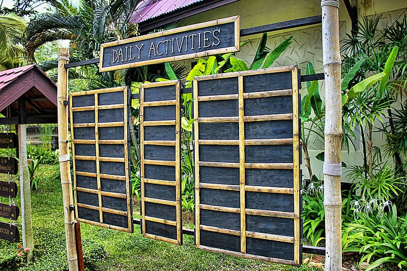 Brown wooden Daily Activities board