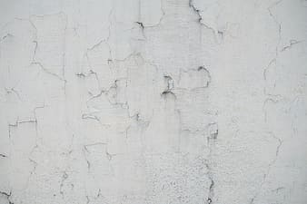 White concrete wall with hole
