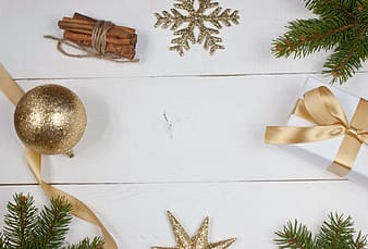 Flat lay photography of gold Christmas baubles and gift box