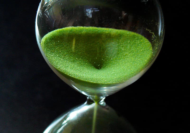 Hourglass with green sands