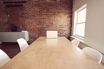 Rectangular beige wooden conference table