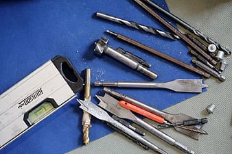 Hand tool lot on blue and gray surface