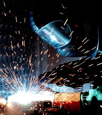 Person with welding mask welding