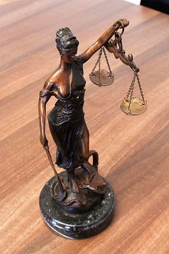 Lady of Justice figurine on table