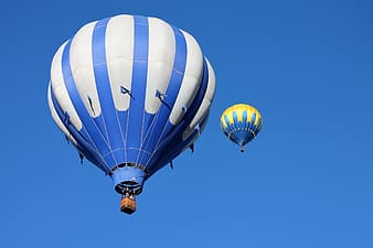 Two hot air balloons under blue sky