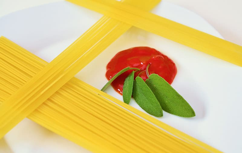 Pasta with green herbs on plate