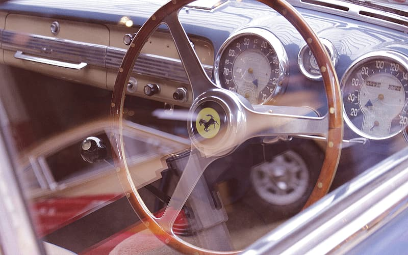 Brown steering wheel in close up photography
