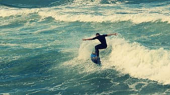 Man surfing on large body of water