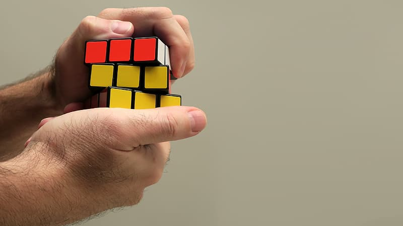 Person playing 3 by 3 cube toy