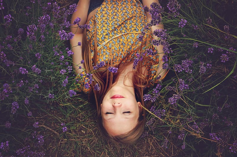 Woman lying on purple flowers