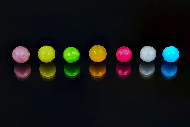 Red green yellow and pink round candies