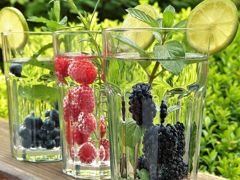 Clear drinking glasses filled with fruits