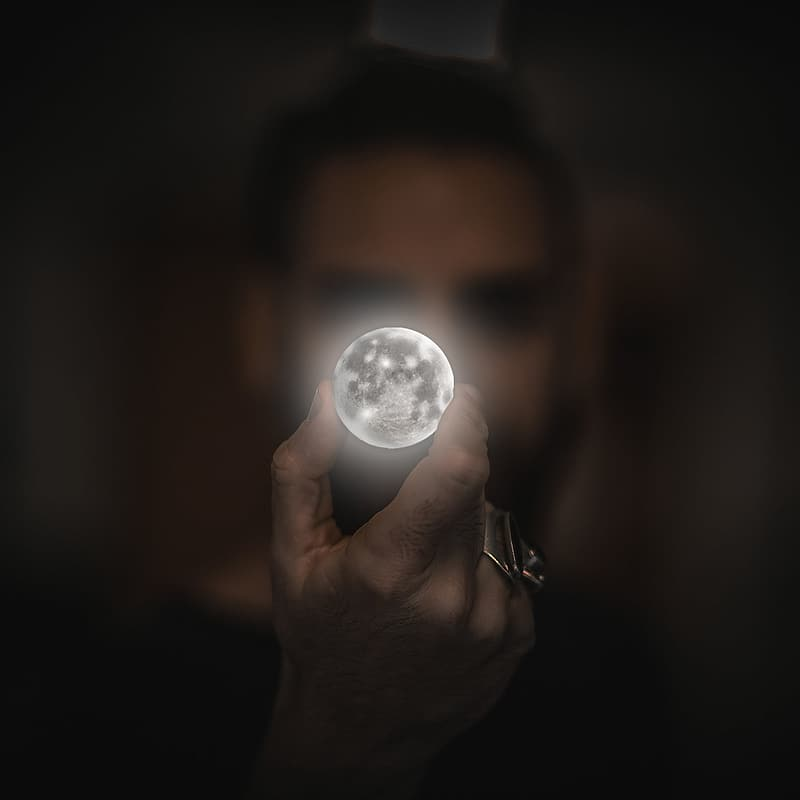 Person holding moon artwork