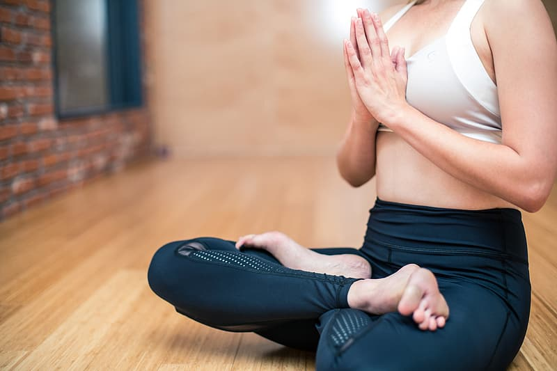 Shallow focus photography of a woman meditating