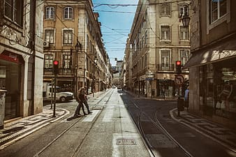 Street shot showing the red lights at a traffic signal in Lisbon, Portugal