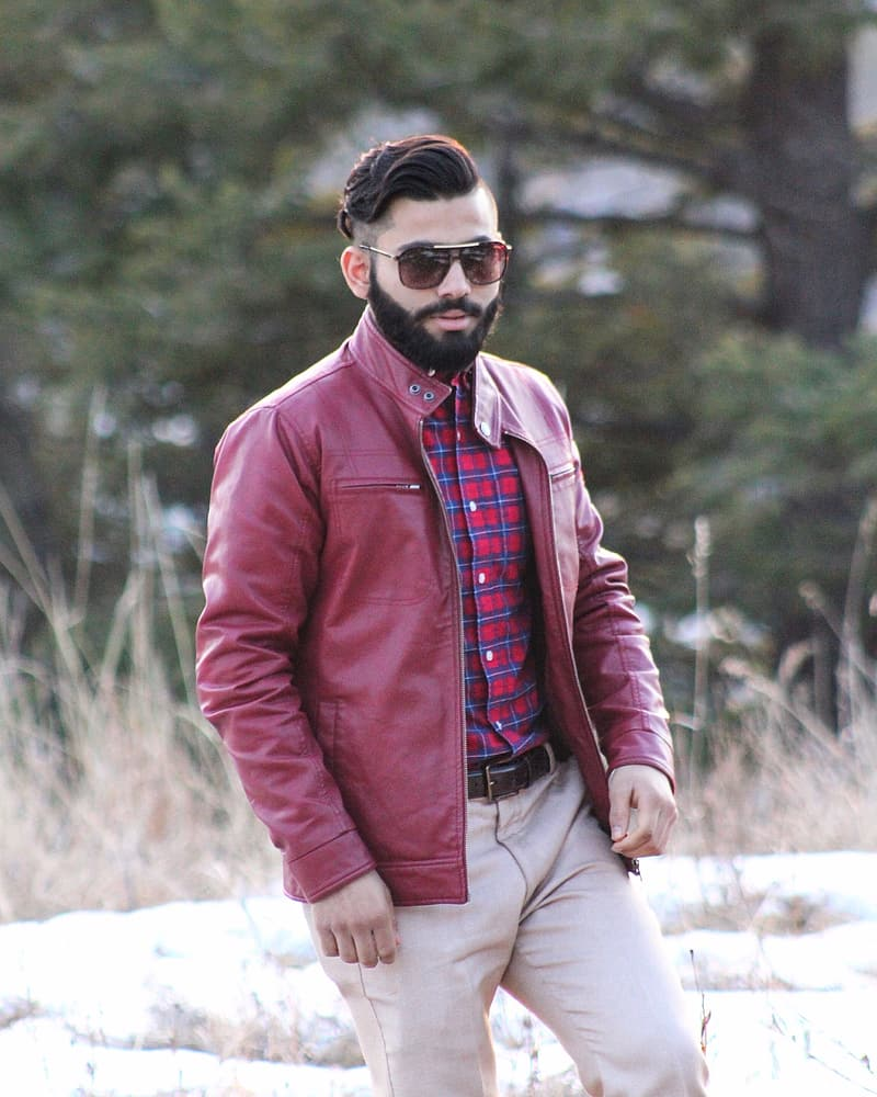 Man in red leather zip-up jacket wearing sunglasses