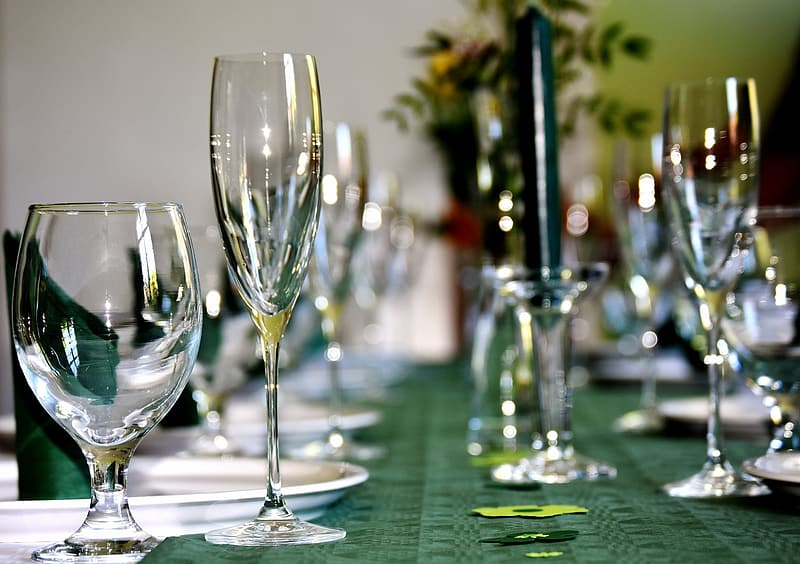 Close-up photography of assorted clear glasses on green table