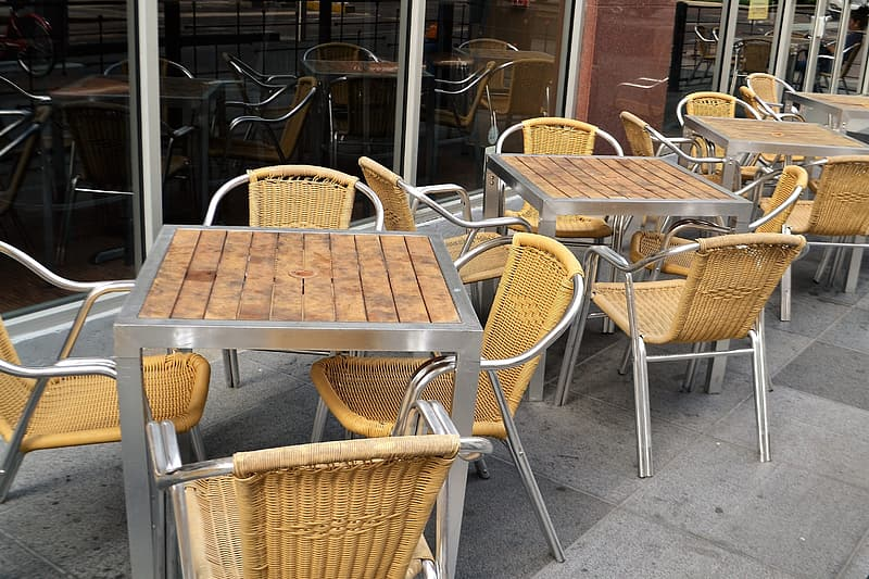 Brown woven chairs and table