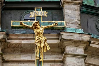 Gold-colored and green crucifix