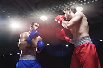 Man in red shorts and red boxing gloves