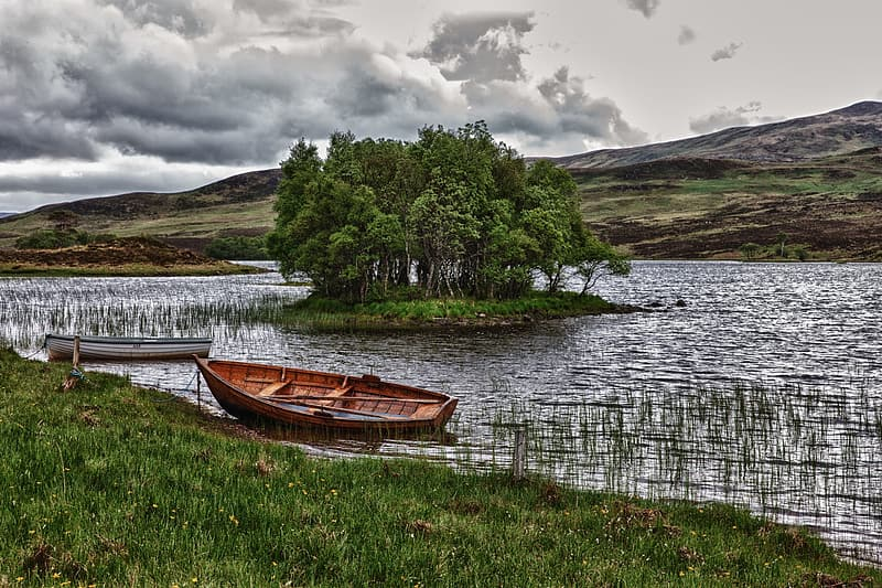 Brown boat on body of water during daytie