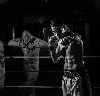 Grayscale photography of boxer inside ring