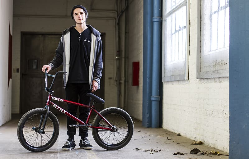 Man holding BMX bike