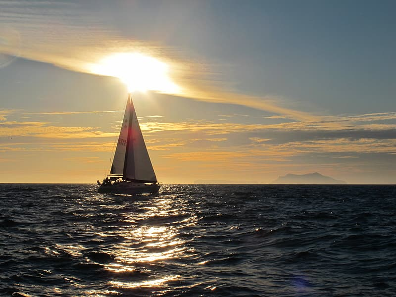 Sail boat on body of water during daytime