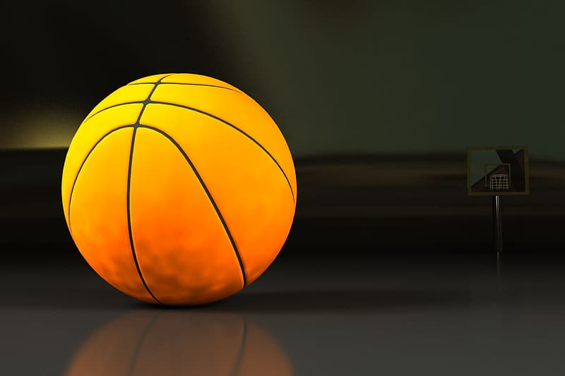 Yellow ball on black surface
