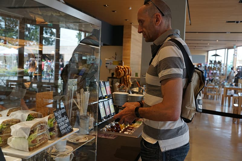 Person standing in front of the display counter