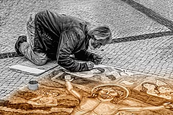 Man painting crucifixion on the road