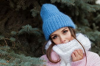 Woman in blue knit cap and white scarf