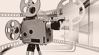 Gray reel-to-reel projector against gray background