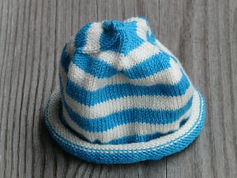 White and blue striped knit cap