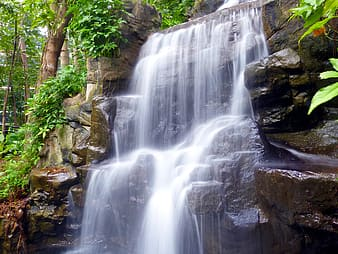 Waterfalls on brown rock formation