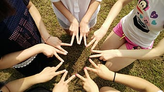 Group of girl forming star using fingers