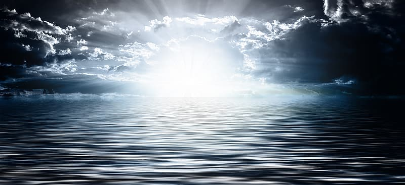 Sun rays over body of water