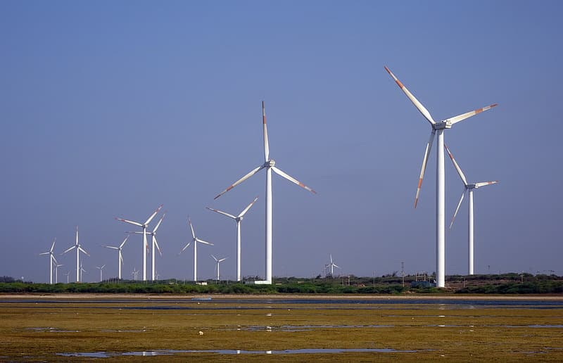 White windmills under blue sky during daytime