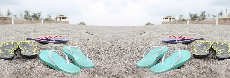 White and green flip flops on brown sand during daytime