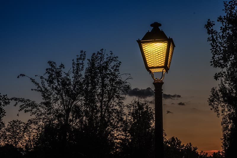 Silhouette photography of lighted post lamp