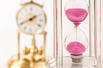 Hour glass with pink sands