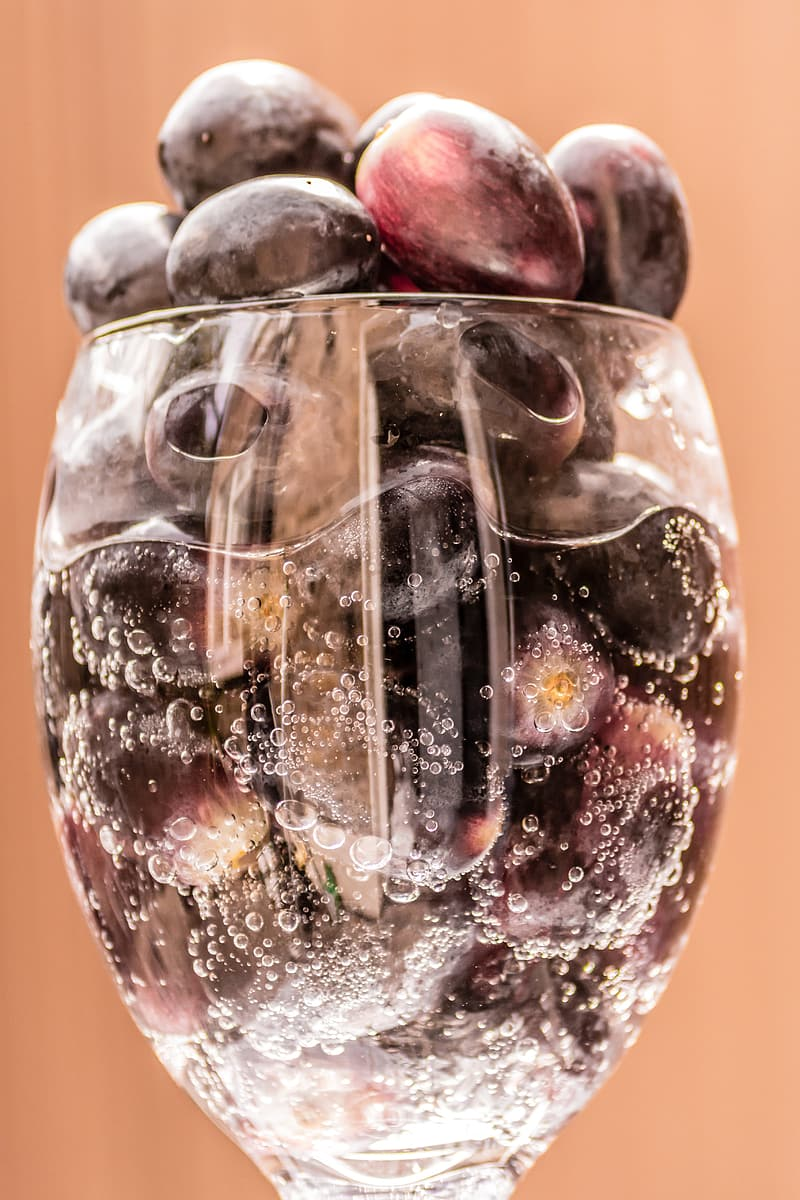 Grape fruits in clear glass