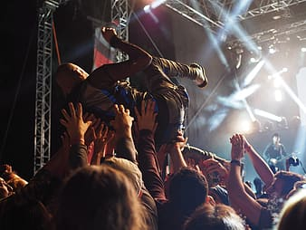 People raising their hands during concert