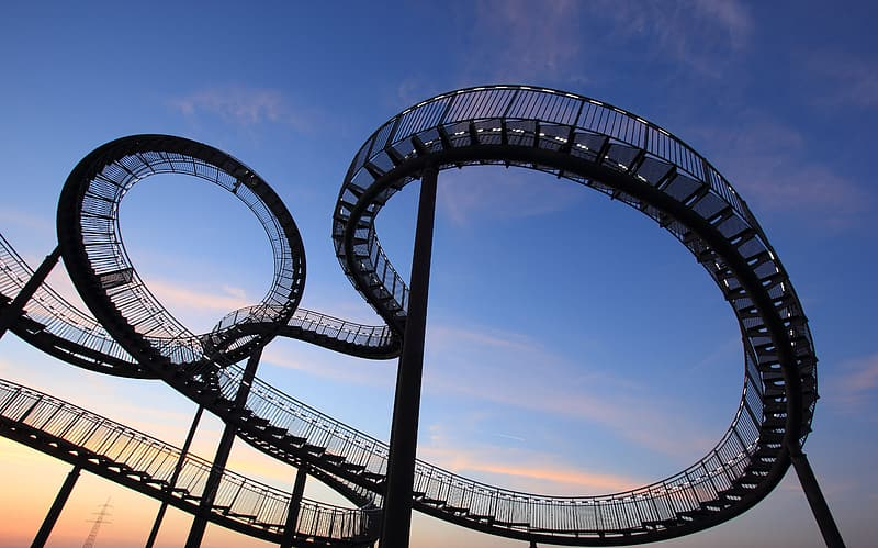 Roller coaster under blue sky and white clouds