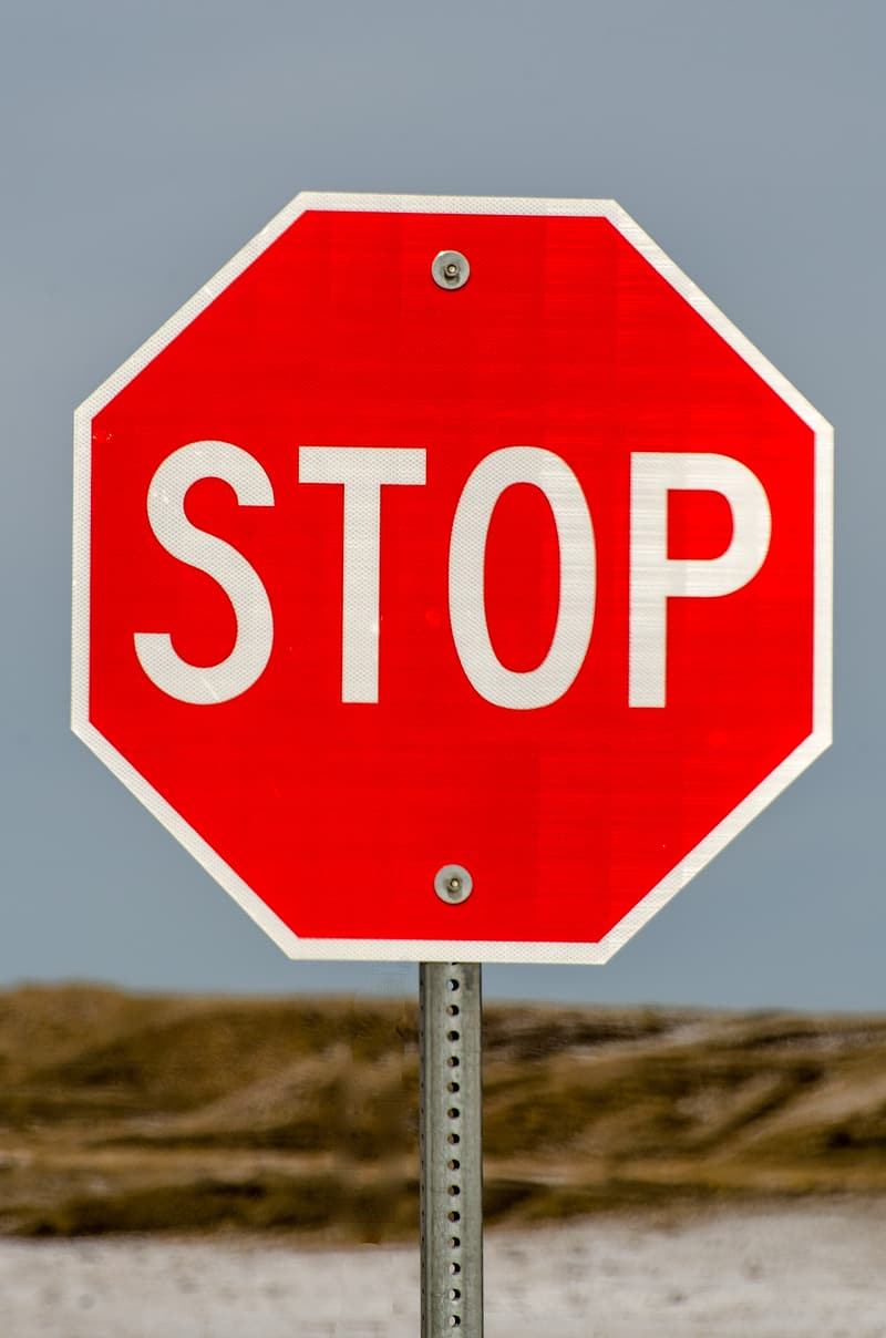 Red stop road sign during daytime