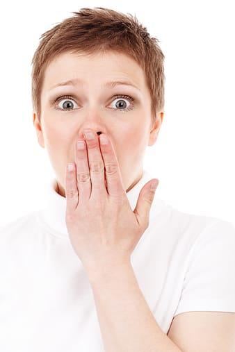 Woman wearing white turtleneck t-shirt shocked emotion