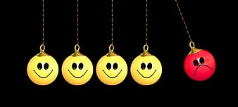 Five yellow and red hanging balls