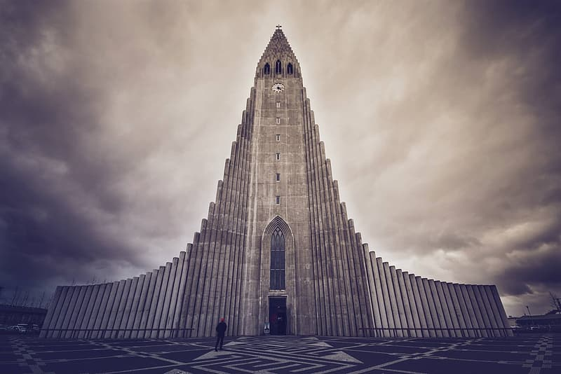 Grey cathedral under cloudy sky in sepia mode photo