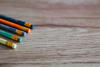 Multi color coloring pen on brown wooden table