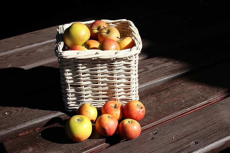 Apple fruits in brown woven basket